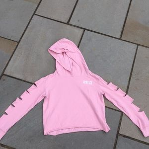 a cropped hoodie with slits in the sleeves
